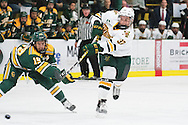 Vermont's Ross Colton (37) shoots the puck past Clarkson's Brett Gervais (19) during the men's hockey game between the Clarkson Golden Knights and the Vermont Catamouts at Gutterson Fieldhouse on Saturday night October 8, 2016 in Burlington. (BRIAN JENKINS/for the FREE PRESS)