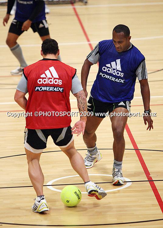 Luke McAlister tries to beat Joe Rokocoko.<br /> All Blacks Training Session at Te Rauparaha Arena, Porirua, Wellington. Monday 15 June 2009. Photo: Dave Lintott/PHOTOSPORT