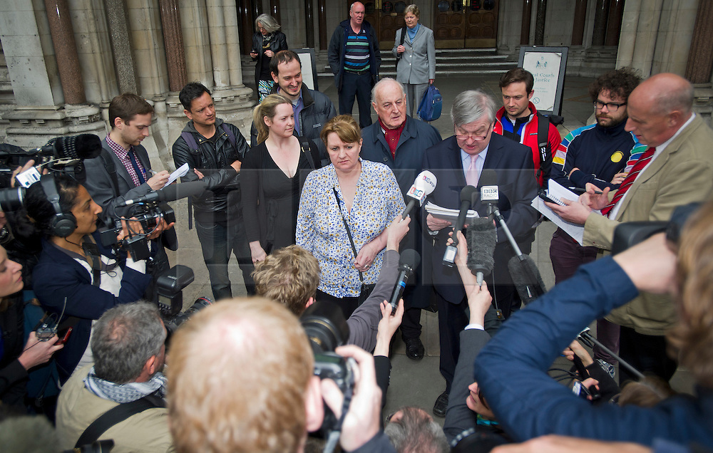 © Licensed to London News Pictures. 17/05/2012. London, UK. PAUL MAY (centre right), who runs the Sam Hallam Campaign reads a statement to the media with SAM HALLAMS mother WENDY COHEN (centre) outside the High Court in London where SAM HALLAM had his 12-year sentence for the murder of  Essayas Kassahun was quashed following an appeal. SAM HALLAM was found guilty of the 2004 murder of Essayas Kassahun, 21, who died after being attacked on the St Luke's estate in Clerkenwell, London on the basis of witness testimony. Photo credit : Ben Cawthra/LNP