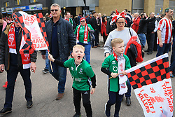 11 March 2017 - The FA Cup - (Sixth Round) - Arsenal v Lincoln City - A young Lincoln fan plays up to the camera - Photo: Marc Atkins / Offside.