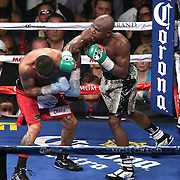LAS VEGAS, NV - SEPTEMBER 13: Floyd Mayweather Jr. (R) lands an overhand right to the head of Marcos Maidana during their WBC/WBA welterweight title fight at the MGM Grand Garden Arena on September 13, 2014 in Las Vegas, Nevada. (Photo by Alex Menendez/Getty Images) *** Local Caption *** Floyd Mayweather Jr; Marcos Maidana