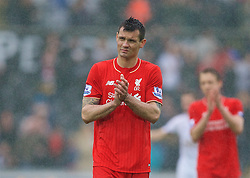 SWANSEA, WALES - Sunday, May 1, 2016: Liverpool's Dejan Lovren applauds the supporters after his side's 3-1 defeat to Swansea City during the Premier League match at the Liberty Stadium. (Pic by David Rawcliffe/Propaganda)