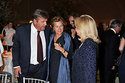 Left to right, JOHAN RUPERT, The MARCHIONESS OF DOURO and MRS JOHAN RUPERT at a dinner hosted by Cartier following the following the opening of the Chelsea Flower Show 2012 held at Battersea Power Station, London on 21st May 2012.