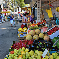 Women Shopping at Green Market in Split, Croatia <br /> Along the eastern wall of Diocletian's Palace is the Green Market. This outdoor marketplace, called Pzar in Croatian, is filled with residents who inspect, squeeze and purchase fresh fruit and vegetables displayed in crates by local merchants. The ambiance is alive with bustling, hustling and bargaining.