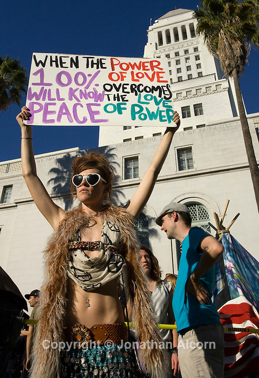 Jessica O'Donnell holds a sign at Occupy LA protest on the lawn at city hall in Los Angeles, California on October 29, 2011. Jonathan Alcorn/JTA .