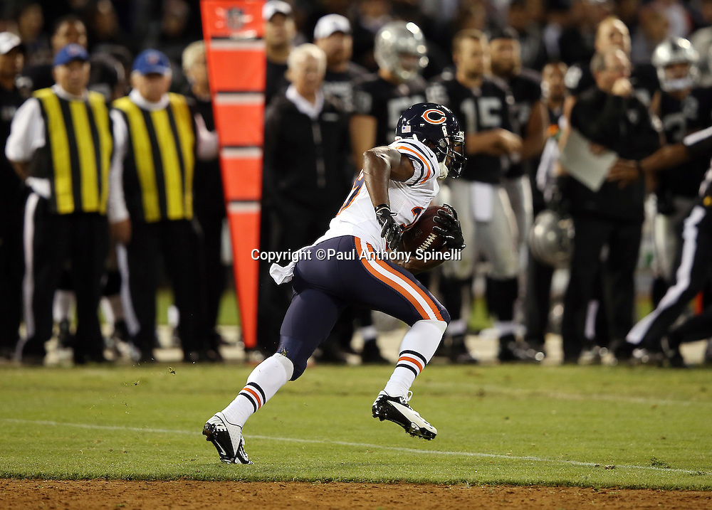 Chicago Bears cornerback C.J. Wilson (39) returns an interception near mid-field late in the fourth quarter during the NFL preseason week 3 football game against the Oakland Raiders on Friday, Aug. 23, 2013 in Oakland, Calif. The Bears won the game 34-26. ©Paul Anthony Spinelli
