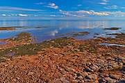 Low tide and red sandstone rocks along the Northumberland Strait<br />Point Prim<br />Prince Edward Island<br />Canada