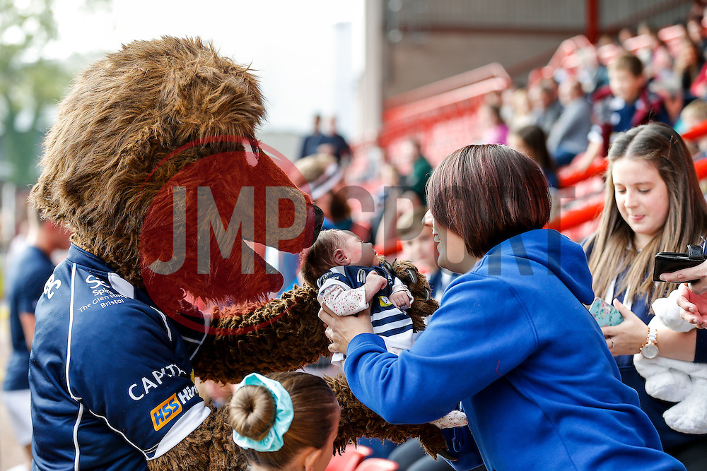 Brizzly holds a young baby in Bristol Rugby kit - Mandatory byline: Rogan Thomson/JMP - 07966 386802 - 04/10/2015 - RUGBY UNION - Ashton Gate Stadium - Bristol, England - Bristol Rugby v Rotherham Titans - Greene King IPA Championship.