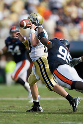Virginia defensive end Jeffrey Fitzgerald (95) breaks up a pass from Georgia Tech quarterback Taylor Bennett (13).  The Virginia Cavaliers football team faced the Georgia Tech Yellow Jackets at Scott Stadium in Charlottesville, VA on September 22, 2007.