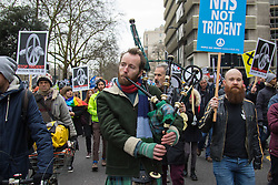London, February 27th 2016. A piper plays Flower of Scotland as hundreds of Scots ad their voice to the crowd during CND's march and rally opposing the UK's Trident nuclear weapons programme. <br /> &copy;Paul Davey<br /> FOR LICENCING CONTACT: Paul Davey +44 (0) 7966 016 296 paul@pauldaveycreative.co.uk
