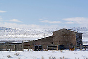 Barns in the in the snow on a cattle ranch in Wyoming WY USA