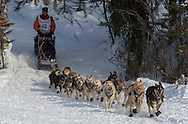 Linwood Fiedler and his team drop down onto Emswiler Lake after starting the 2013 Iditarod in Willow. (Stephen Nowers photo)