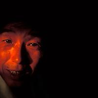 China, Sichuan Province, Setting sun lights face of passenger aboard Yangtze River Ferry