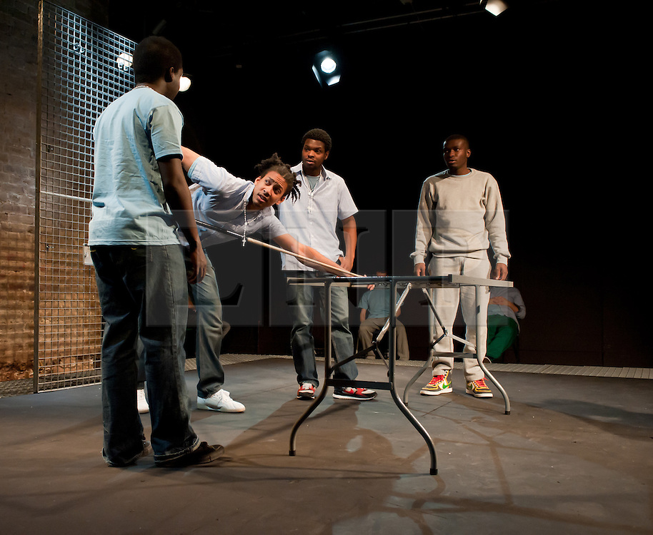 """© Copyright licensed to London News Pictures. 12/11/2010. """"Inside"""" by Philip Osment, presented by Playing Out at the Roundhouse, Camden, London. Based on the real experiences of young fathers in prison, the play deals with big questions surrounding relationships, both with their own fathers and with their children. L o R: Michael Amaning, Kyle Thorne, Darren Douglas, Ayo Bodunrin."""