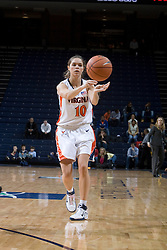 Virginia Cavaliers Guard Brenna McGuire (10) passes the ball in action against Charlotte.  The Virginia Cavaliers women's basketball team defeated The University of North Carolina - Charlotte 49ers 74-72 in the 2nd round of the Women's NIT at John Paul Jones Arena in Charlottesville, VA on March 19, 2007.