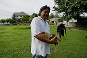 Sabong (cockfighting) trainers in Villa Julita in San Fernando, Philippines. ..Photo by Jason Doiy.6-10-08