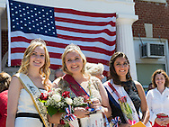 Wantagh, New York, USA. July 4, 2016. L-R,  KERI BALNIS, Miss Wantagh 2015; EMMA CAREY, Miss Wantagh 2016; and BRIANNA COLTELLINO, 1st Runner Up Miss Wantagh 2016; pose in front of large American Flag at the 60th Annual Miss Wantagh Pageant, an Independence Day tradition on Long Island. To their right is Maureen O'Connell, Nassau County Clerk. Since 1956, the Miss Wantagh Pageant, which is not a beauty pageant, crowns an area high school student based mainly on academic excellence and community service.