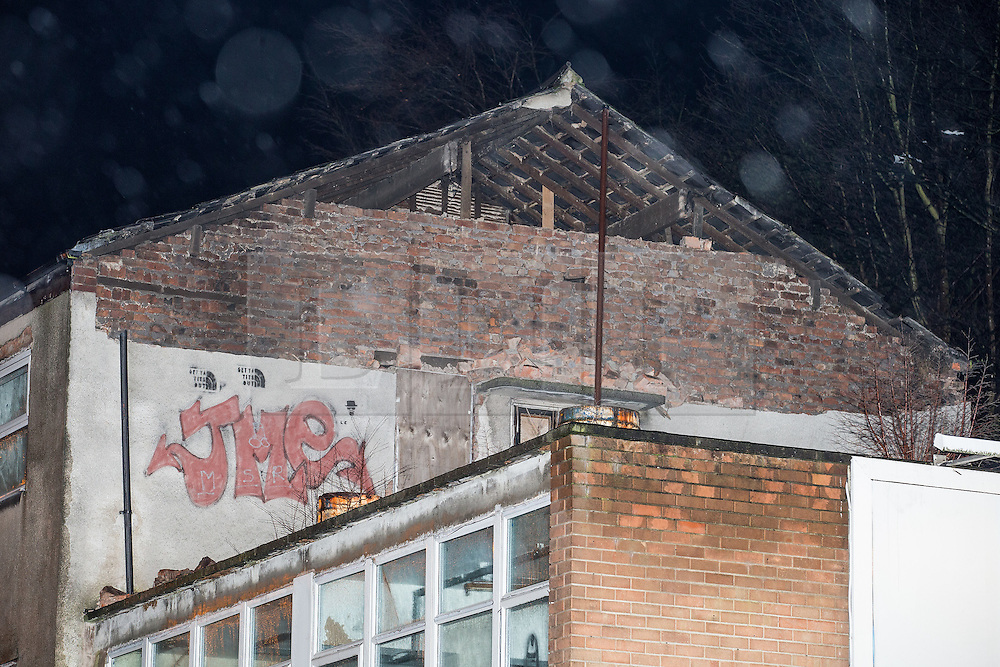 © Licensed to London News Pictures . 15/01/2015 . Middleton , UK . High winds blow out the gable end of a building on Market Place , Middleton , closing the road, as heavy rain and winds cause disruption across the UK .  Photo credit : Joel Goodman/LNP