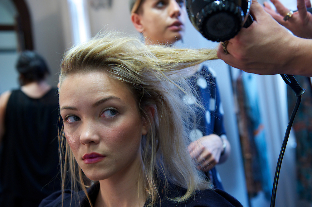 A model is styled backstage before showing the Saloni autumn/spring 2010/2011 collection during a fashion show held in the map room of the Royal Geographical Society, South Kensington, London on 20 September 2010.