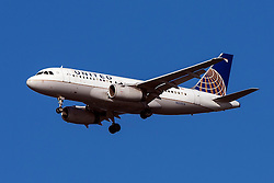 United Airlines Airbus A319-131 (registration N851UA) approaches San Francisco International Airport (SFO) over San Mateo, California, United States of America