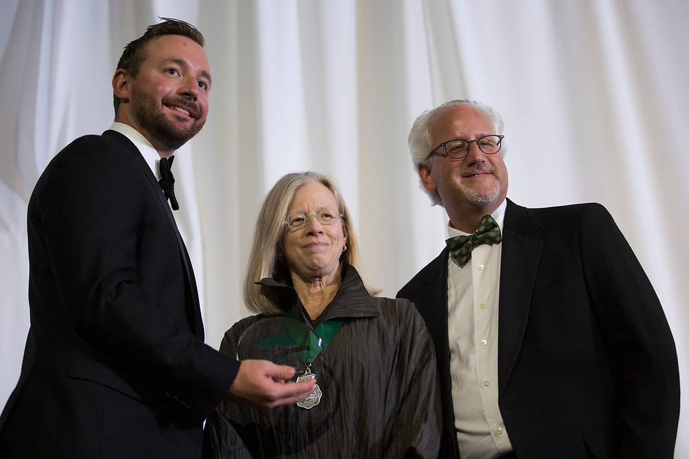 Lynn Johnson accepts a Medal of Merit at the Alumni Awards Gala on October 6, 2017.