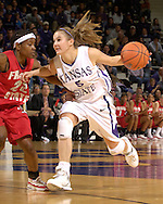 Kansas State's Shalee Lehning (R), drive against Fresno State's Mirenda Swearengin (L), during the second half at Bramlage Coliseum in Manhattan, Kansas, March 22, 2006.  K-State defeated the Bulldogs 64-61 in the second round of the WNIT.