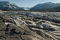 Black Rapids next to Richardson Highway south of Delta during spring breakup; Alaska