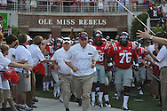 Ole Miss Coach Hugh Freeze leads the team onto the field at Vaught-Hemingway Stadium in Oxford, Miss. on Saturday, September 1, 2012.