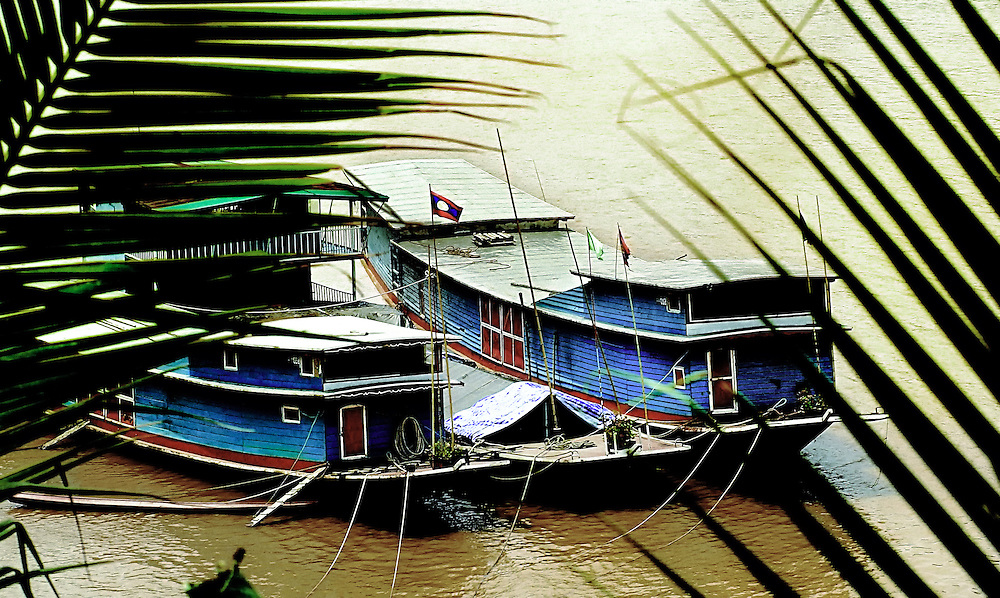 Cargo boats plying the mekong river tied up at Luang Prabang, Laos
