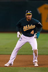 June 28, 2011; Oakland, CA, USA; Oakland Athletics center fielder Coco Crisp (4) leads off first base against the Florida Marlins during the sixth inning at the O.co Coliseum.  Oakland defeated Florida 1-0.