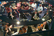 The Johann-Strauss-Gesellschaft plays for passengers at the Panoramasalon...M.S. Johann Strauss, a brand new four star+ river cruiser operated by Austrian River Cruises, and chartered by Club 50 (a travel agency especially for seniors aged 50 and up) undertook an epic 3-week journey (May 21 to June 10, 2004) all the way from Amsterdam to the Black Sea?along Rhine, Main and Danube?, presumably the first passenger vessel ever to have done so. This is one of the images recorded during this historic voyage.