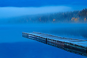 Dock at Blue lake at dawn with fog<br /> Duck Mountain Provincial Park<br /> Manitoba<br /> Canada