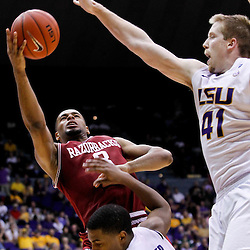 February 4, 2012; Baton Rouge, LA; Arkansas Razorbacks guard Rickey Scott (3) shoots over LSU Tigers guard Ralston Turner (22) and center Justin Hamilton (41) during the second half of a game at the Pete Maravich Assembly Center. LSU defeated Arkansas 71-65.  Mandatory Credit: Derick E. Hingle-US PRESSWIRE