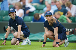 LONDON, ENGLAND - Monday, June 22, 2009: A ball boy and ball girl during a Gentleman's Singles 1st Round match on day one of the Wimbledon Lawn Tennis Championships at the All England Lawn Tennis and Croquet Club. (Pic by David Rawcliffe/Propaganda)