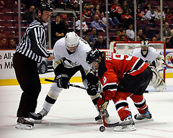 Mar 14, 2007; East Rutherford, NJ, USA;  Pittsburgh Penguins left wing Evgeni Malkin (71) and New Jersey Devils left wing Zach Parise (9) face off during the third period at Continental Airlines Arena in East Rutherford, NJ. Mandatory Credit: Ed Mulholland-US PRESSWIRE Copyright © 2007 Ed Mulholland