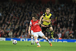 "22.10.2013, Emirates Stadion, London, ENG, UEFA CL, FC Arsenal vs Borussia Dortmund, im Bild Jakub ""Kuba"" Blaszczykowski #16 (Borussia Dortmund) im Zweikampf gegen Tomas Rosicky #7 (Arsenal FC) <br /> <br /> Jakub ""Kuba"" Blaszczykowski #16 (Borussia Dortmund) tackling against Tomas Rosicky #7 (Arsenal FC) // during the UEFA Champions League group F match between Arsenal FC and Borussia Dortmund at the Emirates Stadion in London, Great Britain on 2013/10/22. EXPA Pictures © 2013, PhotoCredit: EXPA/ Eibner-Pressefoto/ Schueler<br /> <br /> *****ATTENTION - OUT of GER*****"