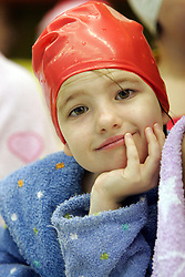 Girl resting in a pool.  (Photo by: Vid Ponikvar / Sportal Images).