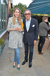 PICTURE SHOWS:-BROOSK SAIB and OLIVIA EMERY.<br /> Tuesday 14th April 2015 saw a host of London influencers and VIP faces gather together to celebrate the launch of The Ivy Chelsea Garden. Live entertainment was provided by jazz-trio The Blind Tigers, whilst guests enjoyed Moët & Chandon Champagne, alongside a series of delicious canapés created by the restaurant's Executive Chef, Sean Burbidge.<br /> The evening showcased The Ivy Chelsea Garden to two hundred VIPs and Chelsea<br /> residents, inviting guests to preview the restaurant and gardens which marry<br /> approachable sophistication and familiar luxury with an underlying feeling of glamour and theatre. The Ivy Chelsea Garden's interiors have been designed by Martin Brudnizki Design Studio, and cleverly combine vintage with luxury, resulting in a space that is both alluring and down-to-earth.