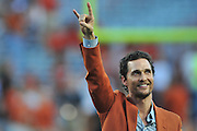 AUSTIN, TX - OCTOBER 18:  Matthew McConaughey puts his horns up before kickoff between the Texas Longhorns and Iowa State Cyclones on October 18, 2014 at Darrell K Royal-Texas Memorial Stadium in Austin, Texas.  (Photo by Cooper Neill/Getty Images) *** Local Caption *** Matthew McConaughey