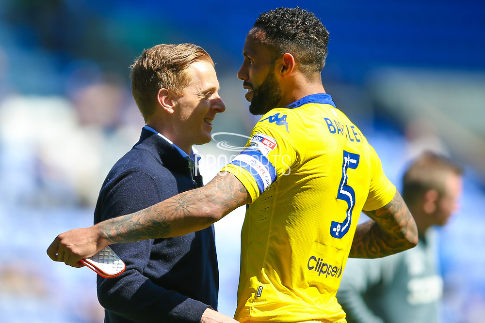 Leeds United manager Garry Monk embraces Leeds United defender, on loan from Swansea City, Kyle Bartley (5)  during the EFL Sky Bet Championship match between Wigan Athletic and Leeds United at the DW Stadium, Wigan, England on 7 May 2017. Photo by Simon Davies.