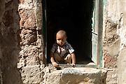 Child at doorway of his home in San'a', Yemen.