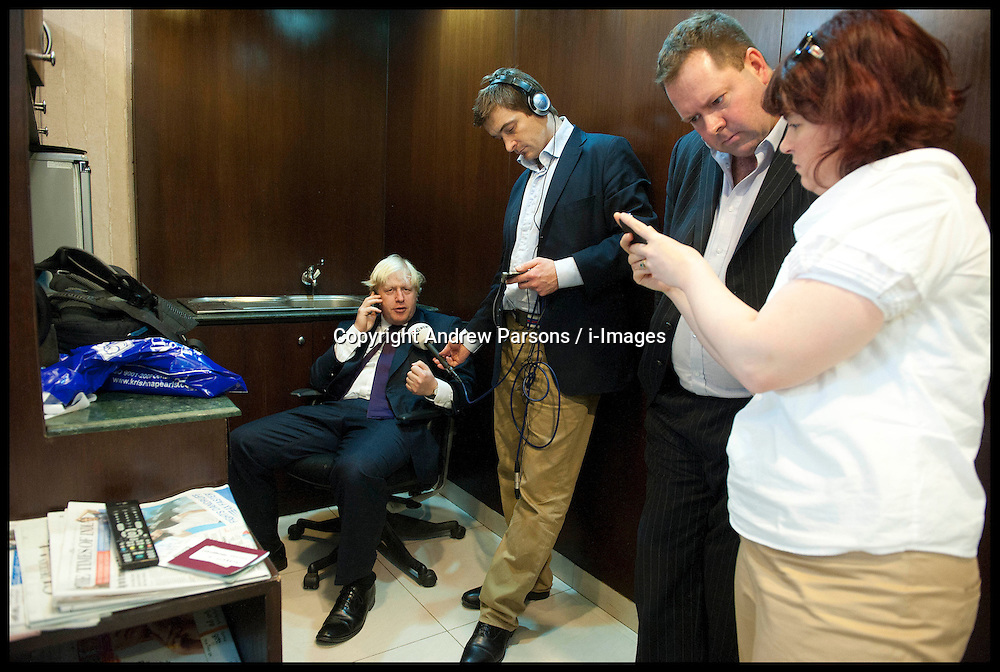 London Mayor Boris Johnson, during a phone in Interview with Nick Ferrari in Hyderabad airport with his Communication Director Will Walden (2nd right) during the forth day of a six-day tour of India, where he will be trying to persuade Indian businesses to invest in London, Wednesday November 28, 2012. Photo by Andrew Parsons / i-Images