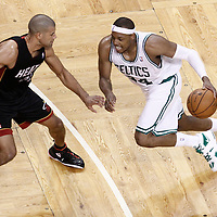 03 June 2012: Boston Celtics small forward Paul Pierce (34) drives past Miami Heat small forward Shane Battier (31) during the Boston Celtics 93-91 overtime victory over the Miami Heat, in Game 4 of the Eastern Conference Finals playoff series, at the TD Banknorth Garden, Boston, Massachusetts, USA.