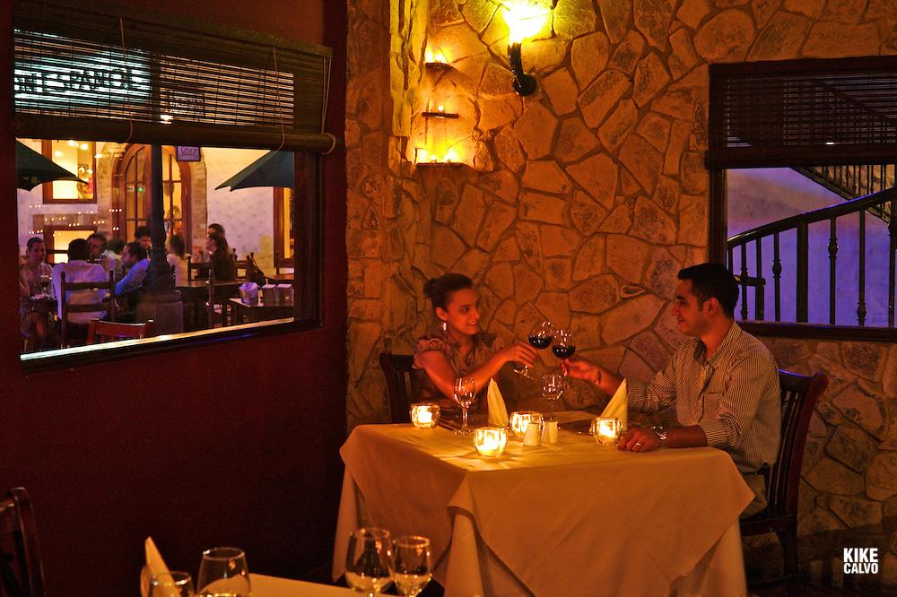 Couple dinning at La Boheme Restaurant in Galerias Santo Domingo.