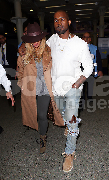 Kim Kardashian and Kanye West arriving St Pancras Eurostar in London, UK. 28/09/2013<br />
