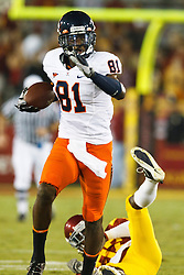 September 11, 2010; Los Angeles, CA, USA;  Virginia Cavaliers wide receiver Dontrelle Inman (81) rushes up field after breaking a tackle from Southern California Trojans cornerback Nickell Robey (37) during the second quarter at the Los Angeles Memorial Coliseum. USC defeated Virginia 17-14.