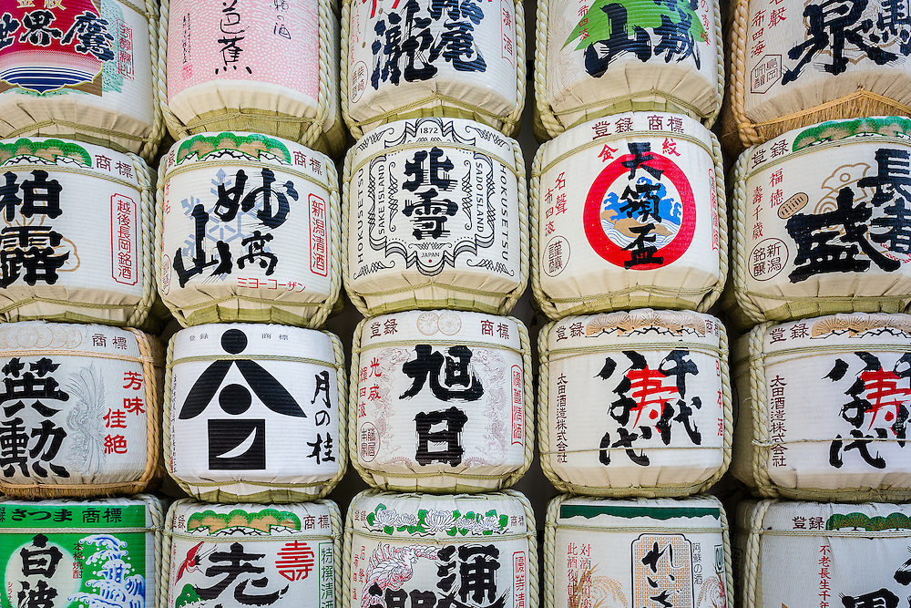 Several barrels of sake, given as offerings, are on display at the entrance of Meiji Shrine.