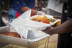 The Penn-Scipio family hosts its 19th annual Thanksgiving Luncheon at Emancipation Garden.   Patrons had the option of macaroni and cheese, sweet potato, cranberry sauce, stuffing, vegetables, rice, turkey, and tofu.  Charlotte Amalie, St. Thomas.  26 November 2015.  © Aisha-Zakiya Boyd