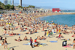 Embargoed to 0001 Saturday May 20 File photo dated 08/09/08 of Platja Nova Icarie beach in Barcelona. A quarter of British holidaymakers who travel overseas do not have insurance, new figures show.