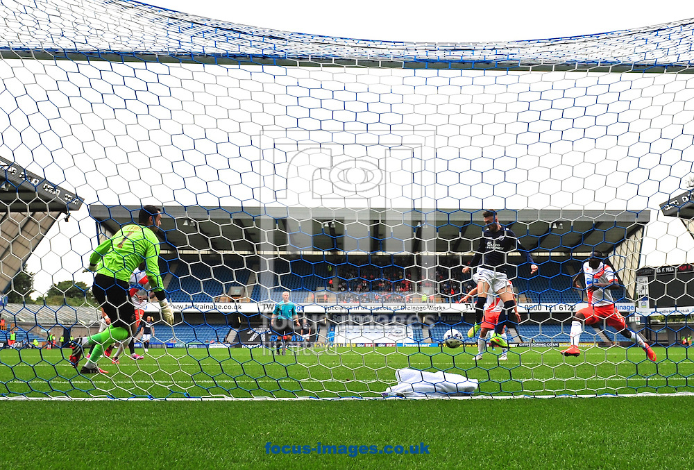 Goalkeeper Joe Lewis of Blackpool scrambles across his goal to try to prevent Scott Malone of Millwall  from scoring during the Sky Bet Championship match at The Den, London<br /> Picture by Alan Stanford/Focus Images Ltd +44 7915 056117<br /> 30/08/2014